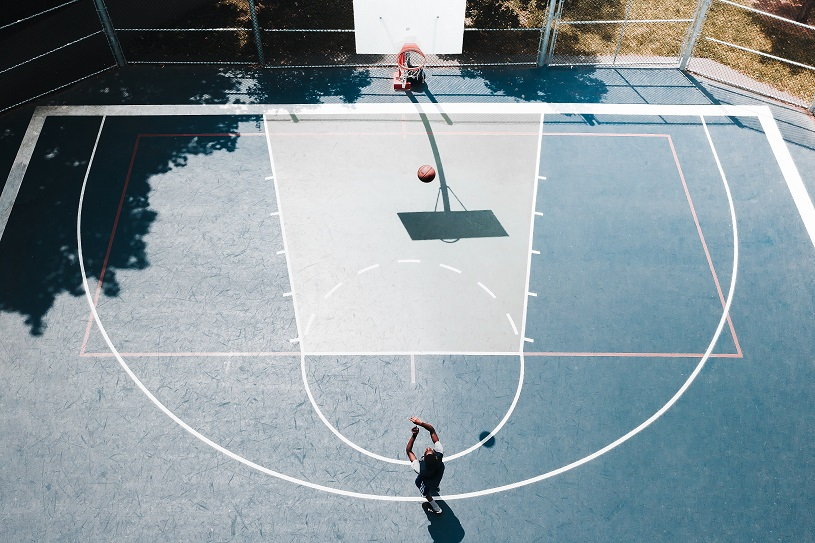 header photo of a young person playing basketball for drug court article